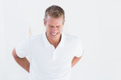 Doctor with back pain Stock Images