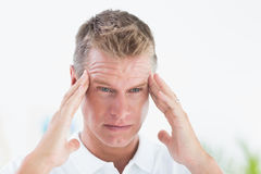 A Doctor with a bad headache Stock Images