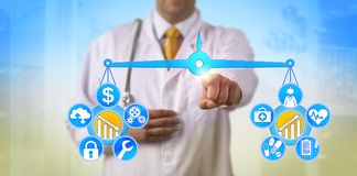 Doctor Balancing Cost And Healthcare Improvement. Unrecognizable doctor balancing out cost of digital health system and data security versus improvement of Royalty Free Stock Photography