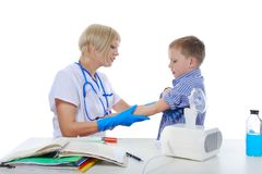 Doctor bandaged the boy finger Royalty Free Stock Photo
