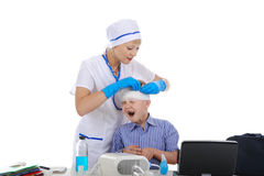 Doctor bandaged the head a little patient Stock Photography