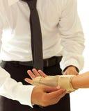 Doctor bandaging female broken hand Stock Photography