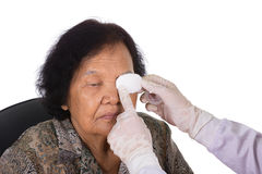 Doctor bandaging patient's eye Royalty Free Stock Photography