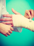 Doctor bandaging sprained wrist. Stock Images
