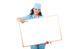 Doctor with banner point to copyspace Stock Photos