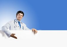 Doctor with banner Royalty Free Stock Image