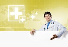 Doctor with banner Royalty Free Stock Images