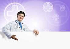 Doctor with banner Royalty Free Stock Photo