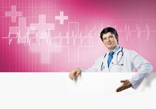 Doctor with banner Royalty Free Stock Photos