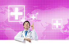 Doctor with banner Royalty Free Stock Photography