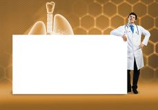 Doctor with banner. Young handsome doctor with white blank banner. Place your text Stock Image