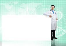 Doctor with banner Stock Images