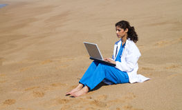 Doctor on beach Stock Photography