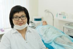 Doctor - beautician holds reception stock photo