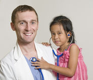 Doctor being examined Royalty Free Stock Photos