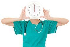 Doctor with a big clock Royalty Free Stock Photo