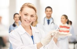 Doctor with big jaws and toothbrush Royalty Free Stock Photos