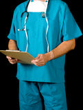 Doctor on black holding a clip board Royalty Free Stock Images