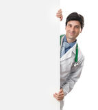 Doctor with blank banner. Isolated on white Royalty Free Stock Photography
