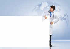 Doctor with blank banner Stock Photography