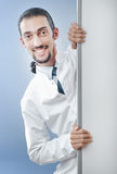 Doctor with blank  board. Doctor with blank message board Royalty Free Stock Photo