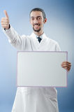 Doctor with blank  board. Doctor with blank message board Royalty Free Stock Photography