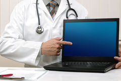 Doctor with blank laptop screen Stock Photos