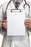 Doctor with blank sign on clipboard Stock Images