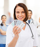 Doctor with blister packs of pills Stock Photo