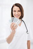 Doctor with blister packs of pills Royalty Free Stock Photo