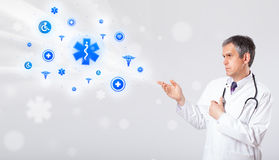 Doctor with blue medical icons Stock Photography