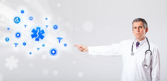Doctor with blue medical icons Royalty Free Stock Image