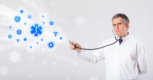 Doctor with blue medical icons Royalty Free Stock Photos