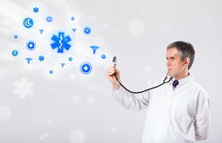 Doctor with blue medical icons Stock Images