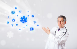 Doctor with blue medical icons Royalty Free Stock Images