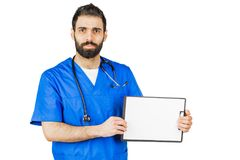 Doctor in blue robe with stethoscope pointing to clipboard isolated on white background.  royalty free stock photos