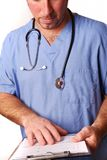 Doctor in blue scrubs Stock Photography