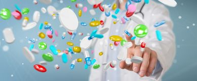 Doctor giving colorful pills for treatment 3D rendering. Doctor on blurred background giving colorful pills for treatment 3D rendering Stock Image