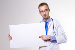 Doctor with board Royalty Free Stock Image