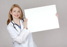 Doctor with board Royalty Free Stock Photography