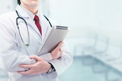 Doctor with board Stock Images