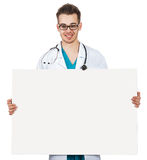 Doctor with a board Stock Images