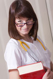 Doctor with book. Young female doctor holding book and looking at the camera Stock Images