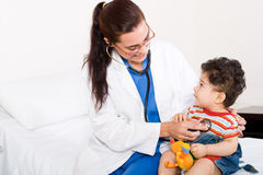 Doctor and boy Stock Images