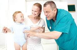 Doctor, boy, happy mother. Stock Photo