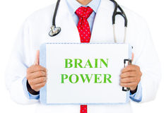 Doctor-brain power. Closeup portrait of a health professional holding up a sign that says brain power, isolated on white background Stock Photos