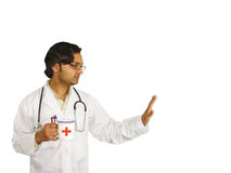 Doctor on break. A doctor holding a tea mug on his break isolated over white stock images