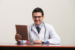 Doctor On A Break With His Touchpad Royalty Free Stock Photography