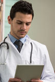 Doctor On A Break With His Touchpad Stock Photography