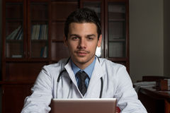 Doctor On A Break With His Touchpad Stock Photos